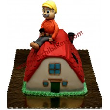 Man on hut cake